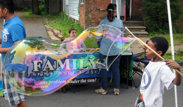 A view of the Family of Woodstock booth, where the materials for monster Bubble making were available during the 10th Annual Midtown Make a Difference Day Celebration, on Franklin Street, in Kingston, NY, on Saturday, June 20, 2015. Photo by Jim Peppler. Copyright Jim Peppler 2015.
